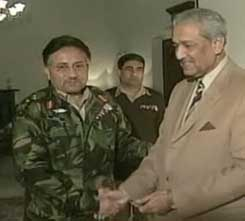 Musharraf and A. Q. Khan. (The date and location of the photo is unknown.)